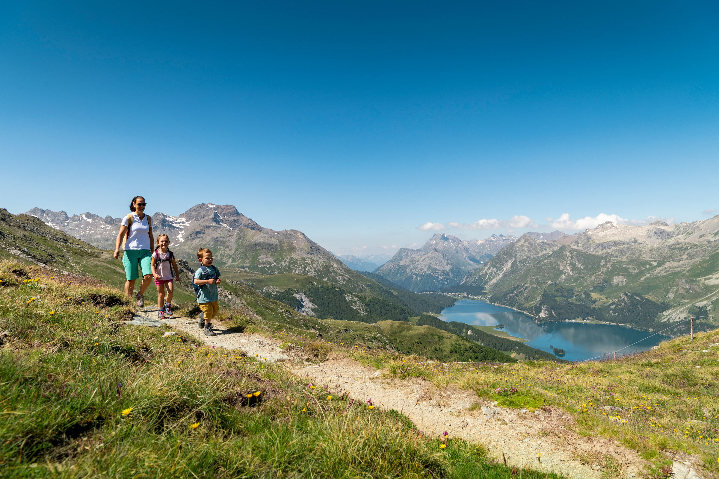 Hiking with view over Lake Sils