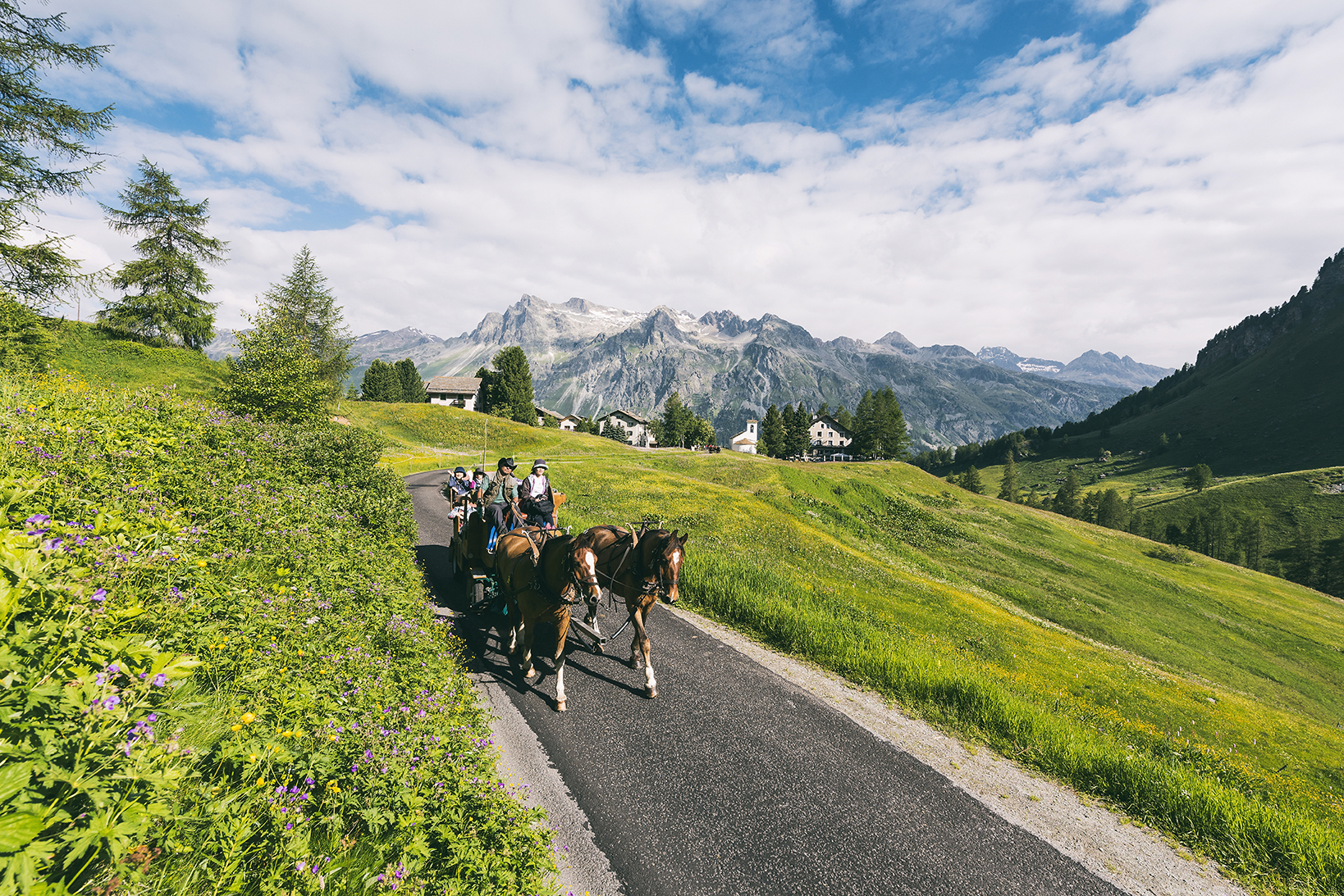 Horse-drawn carriage rides into the Val Fex