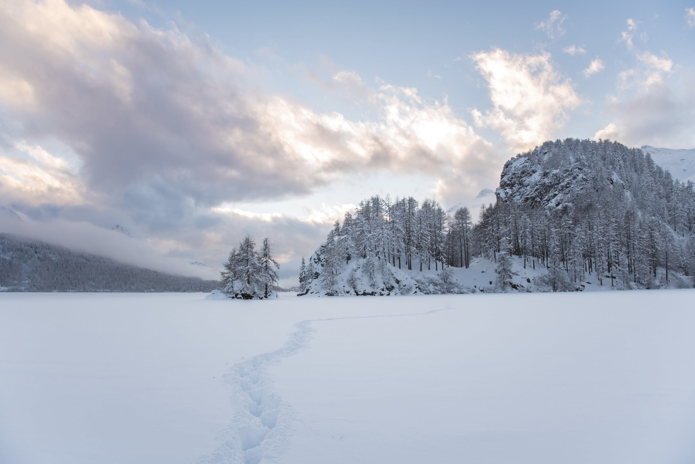 Winter hiking on the frozen Lake Sils